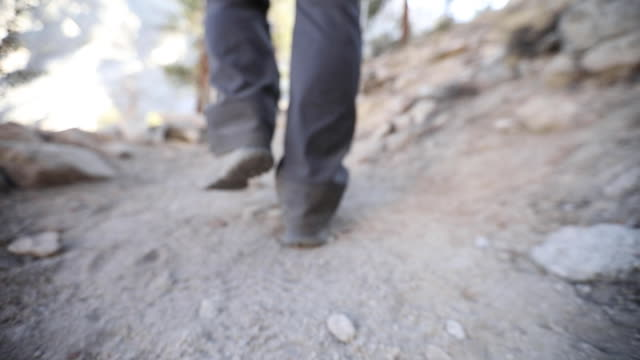 low angle establishing shot following a man hiking a trail on mount whitney in california. - californian sierra nevada stock videos & royalty-free footage