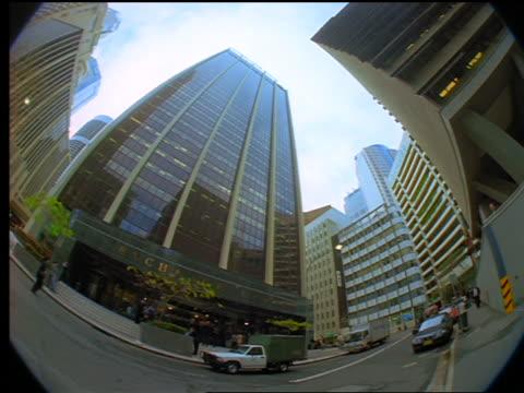 vídeos de stock, filmes e b-roll de fisheye low angle pan exchange center building / sydney, australia - 1990