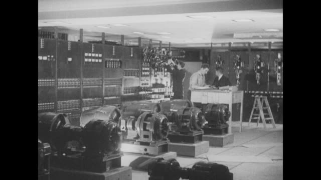 low angle ext shot 30 rockefeller plaza, new home to nbc radio studios, a/k/a the rca building / vs sound engineers at work in the control room /... - rca stock videos & royalty-free footage