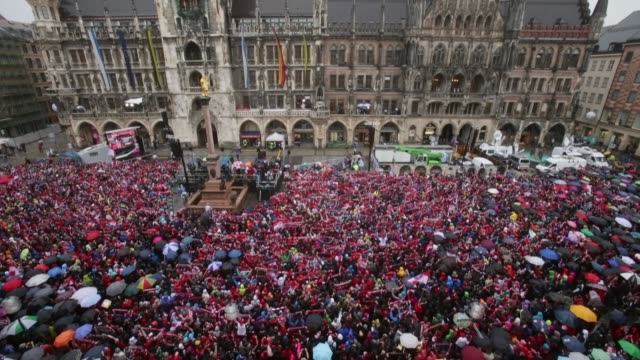Low angle extreme long shot fans of Bayern Muenchen wait in the rain at Marienplatz on June 2 2013 in Munich Germany The team of Bayern Muenchen will...