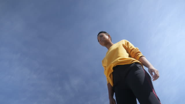 low angle, fashionable african american woman against blue sky - improvement stock videos & royalty-free footage