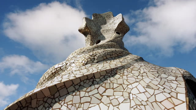 Low angle fast motion medium shot mosaic sculpture on La Pedrera roof/ Barcelona