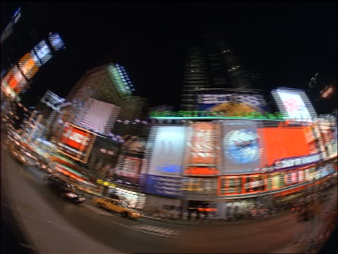 low angle fisheye pan times square at night / new york city - 1998 stock videos & royalty-free footage
