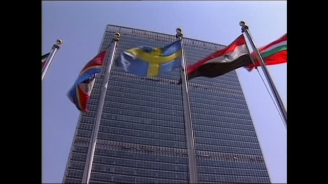 low angle flags outside united nations headquarters; 1992 - identity politics stock videos & royalty-free footage
