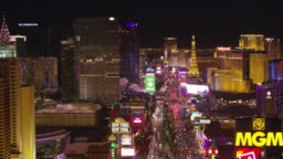 Low angle fly over Las Vegas Strip at night.