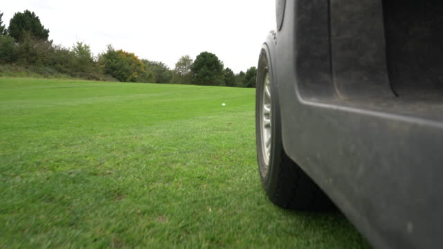 low angle golf cart drive to the ball on the fairway. - golf cart stock videos & royalty-free footage