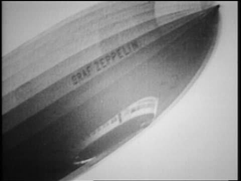 b/w 1929 low angle graf zeppelin flying overhead - airship stock videos & royalty-free footage