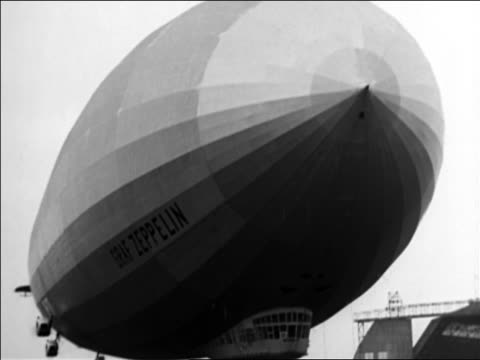 b/w 1928 low angle graf zeppelin rising into sky / germany / documentary - 1928 stock videos & royalty-free footage