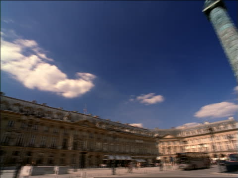 low angle pan green copper column with statue in center of place vendome to buildings around plaza / paris - place vendome stock videos & royalty-free footage