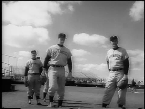 b/w 1962 low angle group of sf giants pitchers practicing at spring training / newsreel - spring training stock videos & royalty-free footage