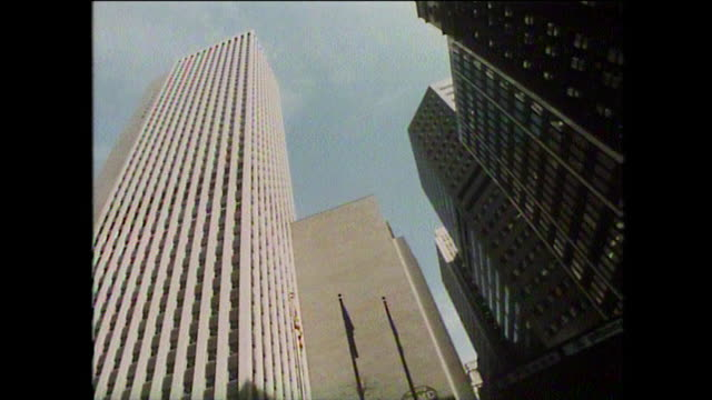 low angle gvs of new york skyscrapers; 1975 - general view stock videos & royalty-free footage