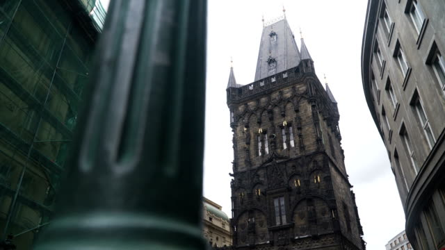 Low angle handheld view of Powder Tower (Prasna Brana) in Prague