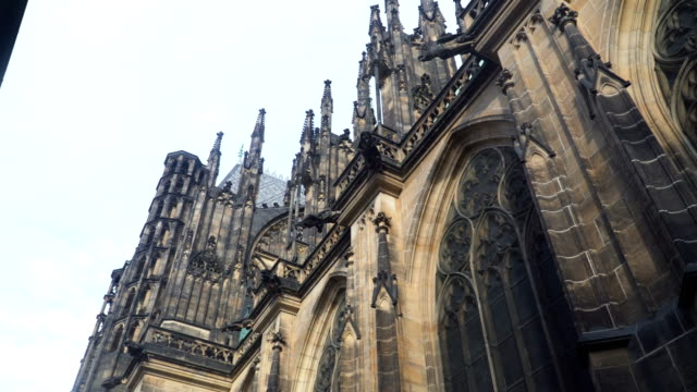 low angle handheld view: walking around st. george's basilica, cathedral church,  prague - gothic style stock videos & royalty-free footage