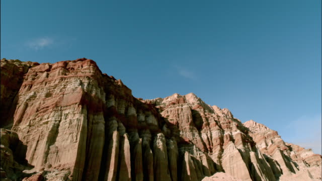low angle hands framing shot of butte / red rock canyon state park, california - film director stock videos & royalty-free footage