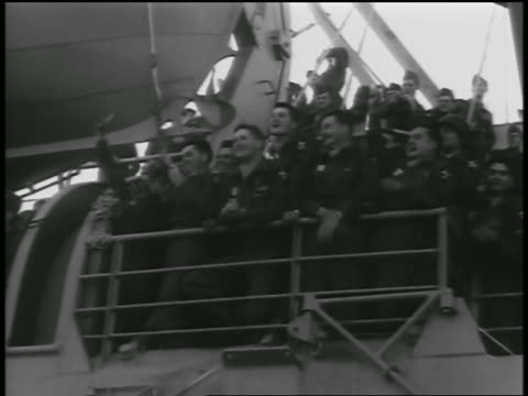 b/w 1954 low angle happy soldiers in uniforms crowded on ship returning from korean war / newsreel - 1954 stock videos and b-roll footage