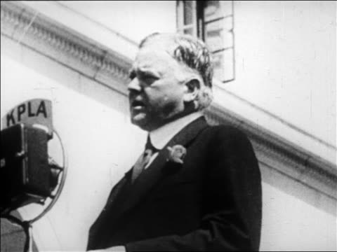 vídeos y material grabado en eventos de stock de low angle herbert hoover speaking into microphone on campaign trail / newsreel - only mature men