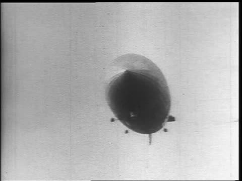 b/w 1937 low angle hindenburg flying toward camera - 1937 stock videos and b-roll footage