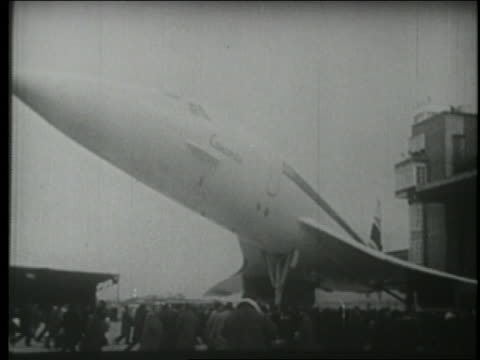 B/W 1969 low angle huge crowd walking underneath first Concorde plane in France