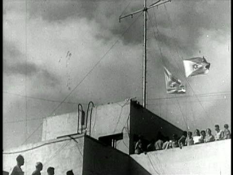 b/w 1948 low angle israeli flag being raised / israel / documentary - 1948 bildbanksvideor och videomaterial från bakom kulisserna