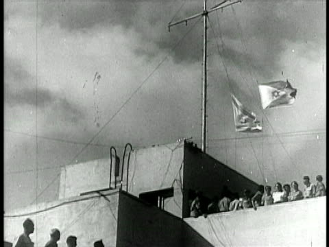 b/w 1948 low angle israeli flag being raised / israel / documentary - 1948 stock-videos und b-roll-filmmaterial