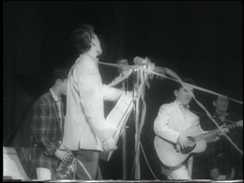 b/w 1958 newsreel low angle japanese rockabilly band playing on stage in concert / tokyo - 1958 stock videos & royalty-free footage