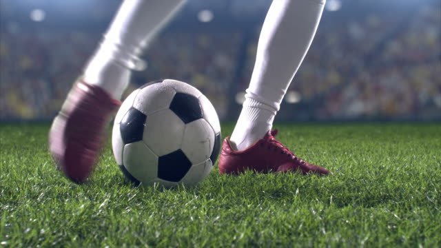 low angle kick by soccer player - football stock videos & royalty-free footage