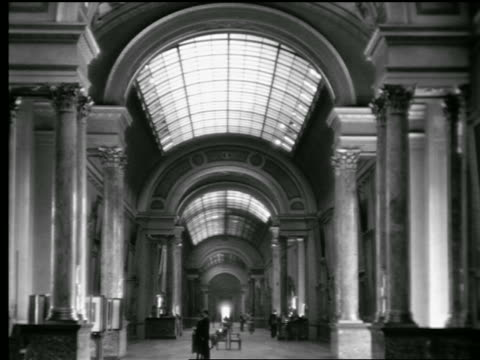 b/w 1927 low angle large arched gallery (grande gallerie / grand gallery?) with skylights inside louvre / paris, france - louvre stock videos and b-roll footage
