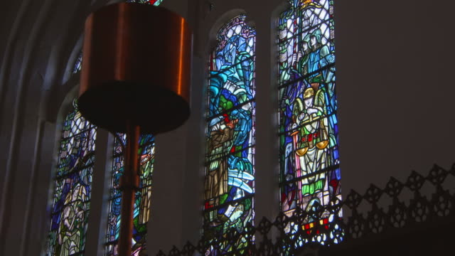 low angle lockdown shot of stained glass window in famous king's college - aberdeen, scotland - natural arch stock videos & royalty-free footage