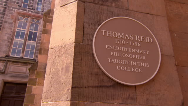low angle lockdown shot of thomas reid placard on stone wall at famous college - aberdeen, scotland - placard stock videos & royalty-free footage