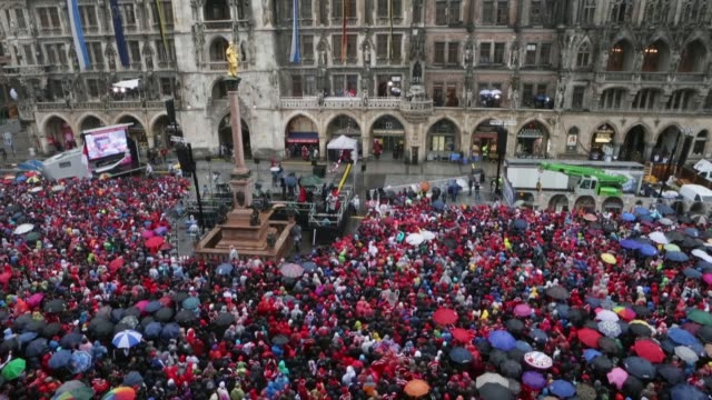 Low angle long shot fans of Bayern Muenchen wait in the rain at Marienplatz on June 2 2013 in Munich Germany The team of Bayern Muenchen will...
