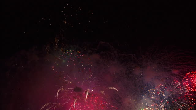 low angle long shot finale of fireworks display in night sky / new york city - firework display stock videos & royalty-free footage
