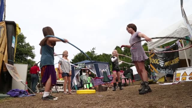 low angle long shot, little girls playing hula hoop at the protestors camp. protesters gather outside a drill site operated by cuadrilla resources... - west sussex stock videos & royalty-free footage