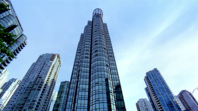 low angle long shot modern steel and glass buildings in vancouver / british columbia, canada - balcony stock videos & royalty-free footage