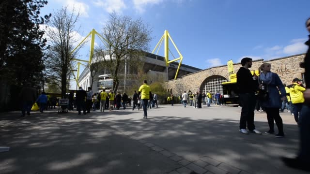 low angle long shot of fans arriving at the stadium signal iduna park general view at signal iduna park on april 20 2013 in dortmund federal republic... - borussia dortmund stock videos and b-roll footage