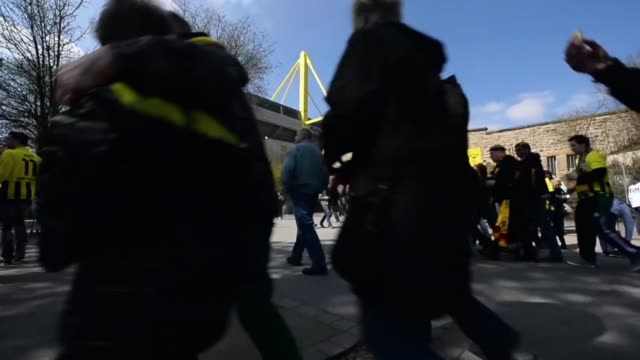 low angle long shot of fans walking towards stadium signal iduna park general view at signal iduna park on april 20 2013 in dortmund federal republic... - borussia dortmund stock videos and b-roll footage