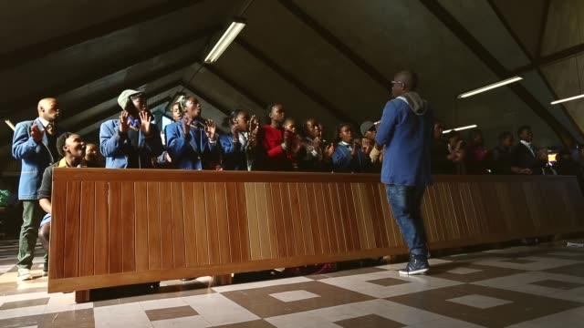 low angle long shot of people singing and dancing at church the congregation prays during a sunday service at regina mundi church in soweto on june... - afrikaans stock videos & royalty-free footage