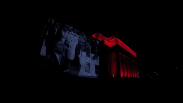 low angle long shot of war archive film projected onto the auckland museum. no sound new zealand celebrates anzac day on april 25, 2013 in various... - anzac day stock videos & royalty-free footage
