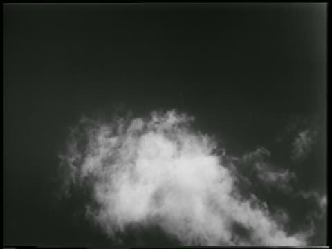 low angle long shot rocket carrying mice + monkey ascending in sky / newsreel - 1952 stock videos & royalty-free footage