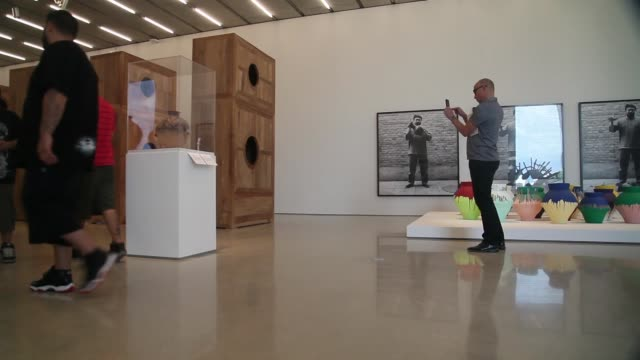 low angle long shot visitors walk through a gallery during the opening day of the pérez art museum miami on december 4 2013 in miami florida the... - biscayne bay stock videos & royalty-free footage