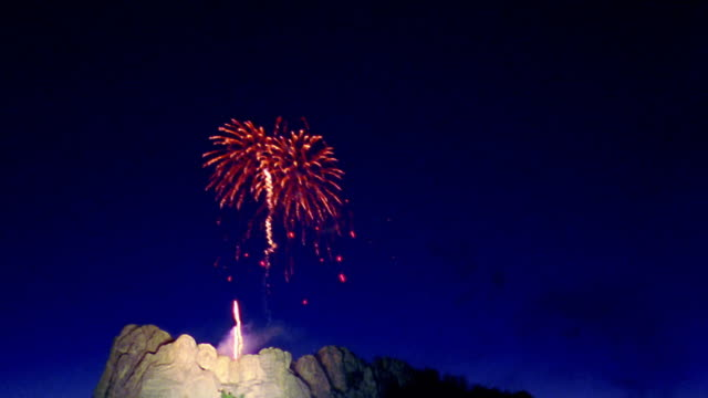 low angle long shot wide shot time lapse fireworks over mount rushmore national memorial / south dakota - mt rushmore national monument stock videos and b-roll footage