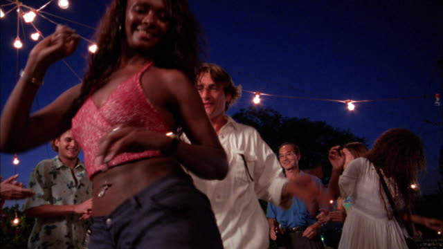 low angle man and woman dance to salsa music while tourists stand + watch / rio de janeiro - belly button piercing stock videos & royalty-free footage