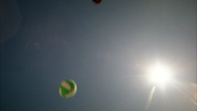 low angle man diving for ball in beach volleyball game / brazil - low angle view stock-videos und b-roll-filmmaterial