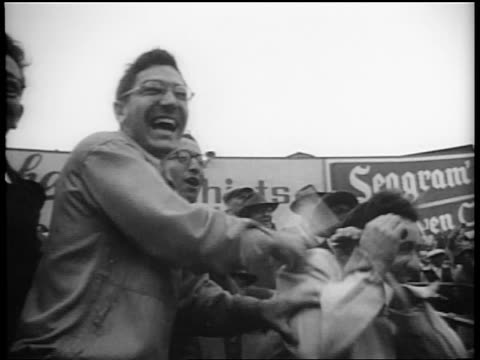 b/w 1953 low angle man in audience cheering hitting other man on arm at end of world series / nyc - 1953 stock videos and b-roll footage
