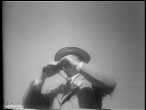 b/w 1953 low angle man in hat eyeglasses looking thru binoculars during indianapolis 500 - 1953 stock videos and b-roll footage