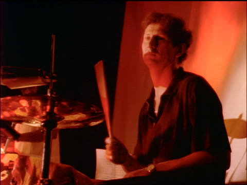 low angle man playing drums on stage - klassischer rock and roll stock-videos und b-roll-filmmaterial