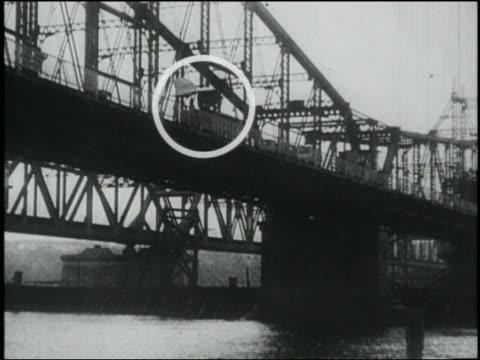 b/w low angle man (edward e. blain) with large wings + tail on back jumps from bridge into thames river, march 28, 1932 , new london, connecticut - new london county connecticut stock videos & royalty-free footage