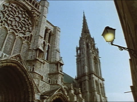 1962 low angle medium shot Chartres Cathedral / lamp light going out in foreground / Chartres, France