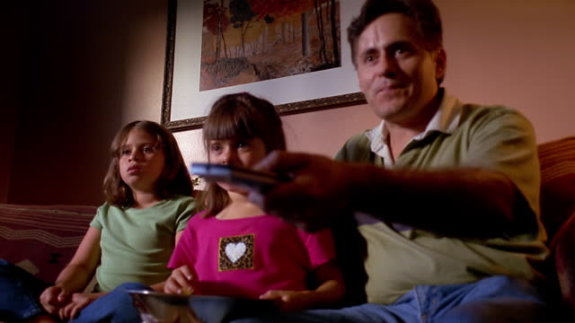 low angle medium shot father watching tv with his children - glee tv show stock videos and b-roll footage
