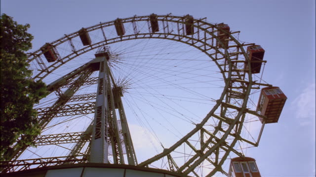 low angle medium shot ferris wheel at prater park/ vienna, austria - prater park stock videos & royalty-free footage