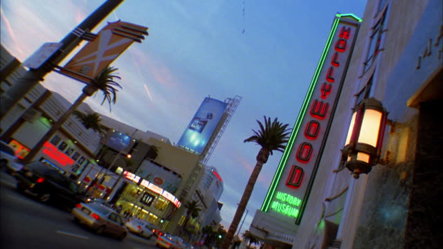low angle medium shot hollywood boulevard w/hollywood wax museum in foreground - hollywood boulevard stock videos & royalty-free footage